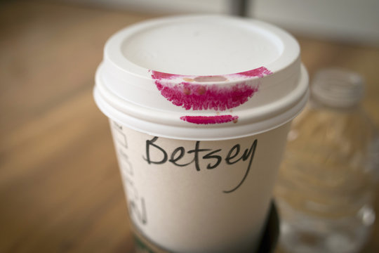 Coffee cup is stained with lipstick of fashion designer Johnson is seen as she holds castings for models in New York