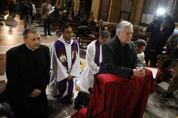 Cardinal Jorge Urosa Savino of Venezuela prays before a Mass in honor of the late Venezuelan President Hugo Chavez in Rome