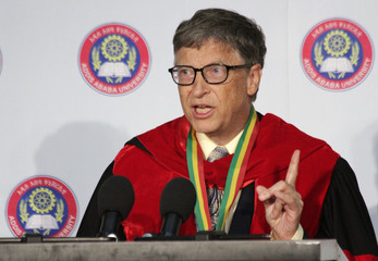 Microsoft technology advisor Bill Gates delivers an address during an awards ceremony which confers an honorary Doctorate Degree on the Microsoft founder at the Addis Ababa University