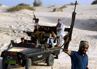 Anti-Gaddafi fighters patrol coast near town of Al Washka some 140 km west of Sirte, one of Muammar Gaddafi's  last remaining stronghold