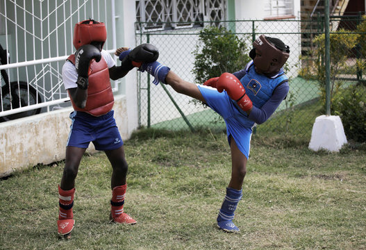 Cuban children spar during a kickboxing exhibition as part of a performance to commemorate International Women's Day in Havana
