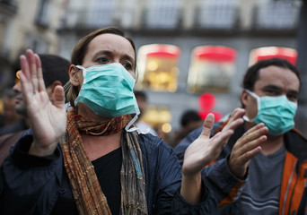 Demonstrators attend a protest of the government's handling of Ebola in Madrid