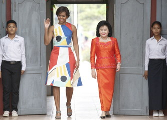 U.S. first lady Michelle Obama (L) and Bun Rany, Cambodia's first lady (R), arrive at Hun Sen Prasaat Bankong high school on the outskirts of Siem Reap