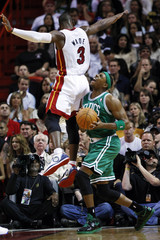 Miami Heat's Dwyane Wade fouls Boston Celtics' Paul Pierce during the second quarter of NBA basketball action in Miami