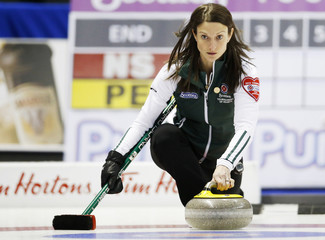 Prince Edward Island skip Suzanne Birt throws a rock against Nova Scotia during the thirteenth draw at Scotties Tournament of Hearts curling championship in Kingston