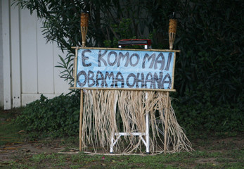 "A sign that means ""Welcome Obama Family"" is posted near the house, where U.S. President Barack Obama is staying while he is on Christmas vacation, in Hawaii"