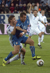 Italy's Cassano challenges Faroe Islands' Baldvinsson during their Euro 2012 qualifying soccer match in Torshvan