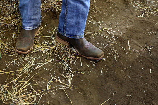 """A man in cowboy boots waits for Republican nominee Trump to speak at """"Joni's Roast and Ride"""" in Des Moines"""