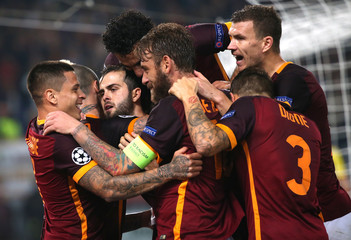 AS Roma's Pjanic celebrates with his teamates after scoring against Leverkusen's during their Champions League soccer match in Rome