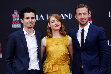 Director Chazelle poses with actors Stone and Gosling after they placed their handprints, footprints and signatures in cement during a ceremony in the forecourt of the TCL Chinese theatre in Hollywood
