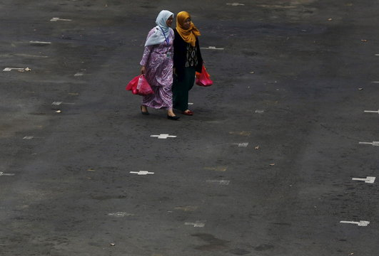 Women shop at a local food market on a hazy day in Putrajaya