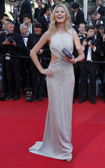 """Model Toni Garrn poses on the red carpet as she arrives for the screening of the animated film """"The Little Prince """" out of competition at the 68th Cannes Film Festival in Cannes"""