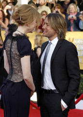 Actress Nicole Kidman and her husband musician Keith Urban arrive at the 17th annual Screen Actors Guild Awards in Los Angeles
