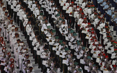 Indian soldiers play musical instruments during the Commonwealth Games closing ceremony at the Jawaharlal Nehru stadium in New Delhi