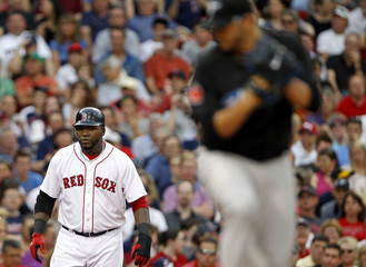 Boston Red Sox designated hitter Ortiz looks on from third base as Toronto Blue Jays starting pitcher Cecil pitches during their MLB American League baseball game in Boston