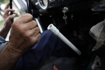 83-year-old Oscar Almaguer uses a piece of plastic bathroom pipe to shift gears as he drives his 1967 Volkswagen Beetle in Apodaca