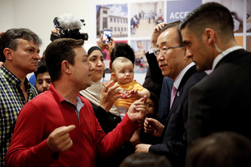 U.N. Secretary-General Ban Ki-moon meets with refugees during an event organised by Solidarity Now, a network of local relief organisations, in Athens