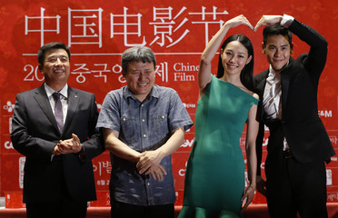"""Cast members Peng and Bai pose for photographers during news conference to promote their movie """"A Wedding Invitation"""", the closing film of Chinese Film Festival, in Seoul"""