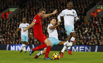 West Ham United's Mark Noble blocks a shot from Liverpool's Jordan Henderson