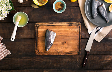 Raw fish with lemon and spices for cooking healthy food