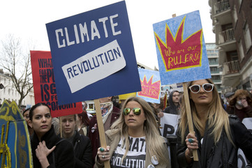 Demonstrators hold placards during an anti-fracking protest in central London