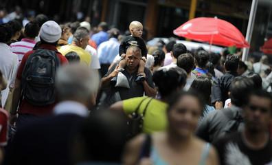 People walk down the main street of San Jose