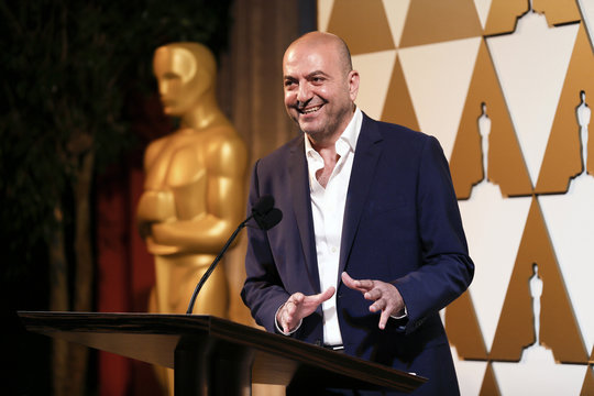 Director Hany Abu-Assad accepts his nomination certificate at the 86th Academy Awards Foreign Language Nominee Reception in Los Angeles