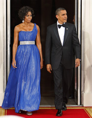 First lady Michelle Obama and U.S. President Barack Obama exit the White House in Washington