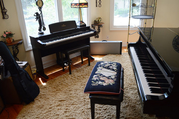 Pianos sit in a small nook of the 7,000 square-foot, five-bedroom waterfront house of former TV star and teen idol David Cassidy that is up for auction in Fort Lauderdale