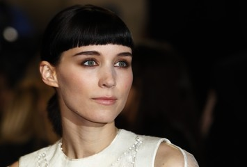 """U.S. actor Mara poses at the world premiere of """"The Girl with the Dragon Tattoo"""" at the Odeon in London"""