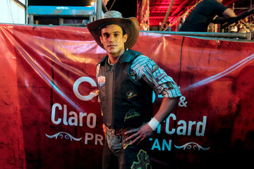 Rodeo bullfighter poses for picture before riding bull during the bull riding event in Managua
