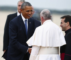 U.S. President Obama welcomes Pope Francis to the United States upon arrival at Joint Base Andrews outside Washington