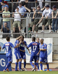 FC Lausanne-Sport's Roux celebrates scoring his goal with team mates during their Swiss Super League soccer match against FC Zurich in Lausanne
