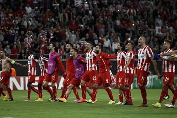 Olympiakos' players celebrate their victory after their Champions League soccer match against Juventus at Karaiskaki stadium at Karaiskaki stadium in Piraeus, near Athens