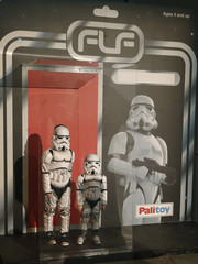 Children dressed as Storm troopers pose for a photograph in a life size toy box at the  'For The Love of The Force' Star Wars fan convention in Manchester