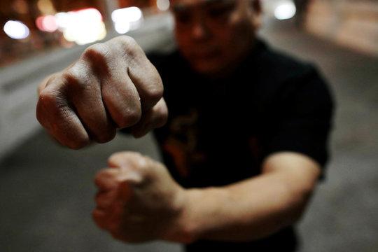 Dragon Sign Kung Fu master Wong Yiu-kau shows his fists at a martial arts class in Hong Kong