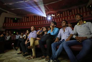 "Cinema goers watch Bollywood movie ""Dilwale Dulhania Le Jayenge"" inside Maratha Mandir theatre in Mumbai"