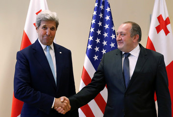 U.S. Secretary of State John Kerry shakes hands with Georgia's President Georgy Margvelashvili during a meeting in Tbilisi