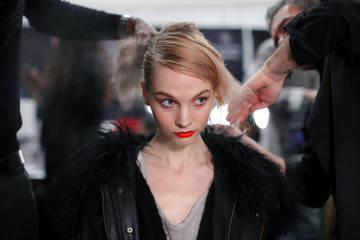 A model gets ready backstage before the Whitney Eve Fall/Winter 2012 collection show during New York Fashion Week