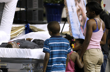 Family and friends pay their respects as they attend the funeral of Alton Sterling, in Baton Rouge