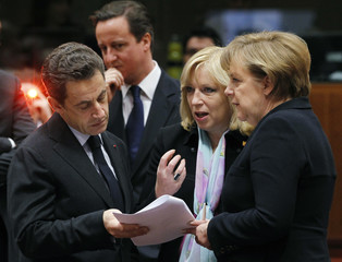 French President Sarkozy, Britain's PM Cameron, Slovakia's PM Radicova and German Chancellor Merkel gather during an EU leaders summit in Brussels