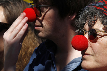 Demonstrators wear red clown noses during a protest in front of the presidential palace in Lisbon