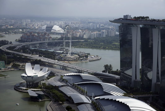 A view of the Singapore Flyer observatory wheel and the National Stadium next to the Marina Bay Sands hotel in Singapore