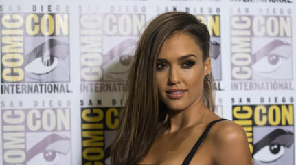 """Cast member Alba poses at a press line for """"Sin City: A Dame to Kill For"""" during the 2014 Comic-Con International Convention in San Diego"""