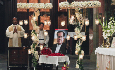A portrait of the assassinated Governor of Punjab Salman Taseer is displayed during a Sunday service at the Cathedral Church of the Resurrection in Lahore