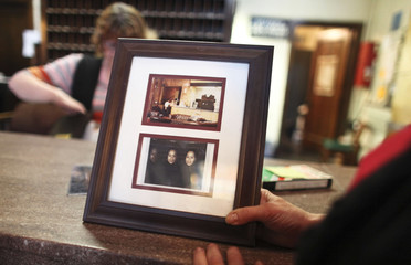 Hotel manager Robin Brekhus decribes the top image in the frame as having a cowboy sitting on the couch while those who took the photo claim no one was sitting there at the time at the Gadsden Hotel in Douglas