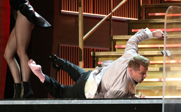 Host James Corden falls down the stairs at the 59th Annual Grammy Awards in Los Angeles