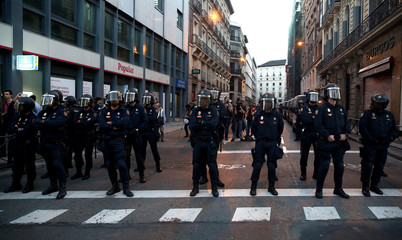 Police block a street during a protest against the investiture of acting Prime Minister and Popular Party leader Mariano Rajoy in Madrid