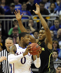 Kansas' Robinson is pressured by Baylor's Jones during the semif-inals of the NCAA men's Big 12 basketball tournament in Kansas City, Missouri