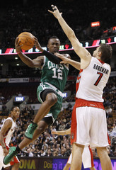 Boston Celtics' Wafer goes to the basket against Toronto Raptors' Bargnani during the first half of their NBA preseason basketball game in Toronto